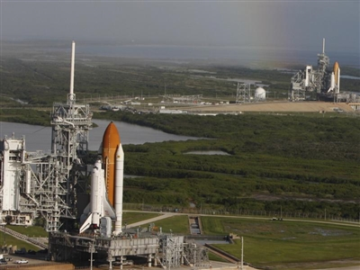 Shuttle Endeavour in foreground, Atlantis in distance, on launch pads